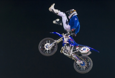 reno: RENO , USA - JUNE 30 : unidentified rider giving FMX motorcross demonstration as part of the Reno Rodeo a Professional Rodeo held in Reno ,USA on June 30 2013