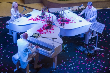 carnevale: LAS VEGAS - JULY 16 : Pianists perform at the Carnevale experience festival in the Venetian Hotel in Las Vegas on July 16, 2013.  Editorial