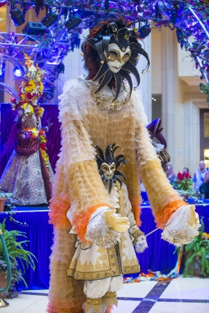 carnevale: LAS VEGAS - JULY 16 : Performers with Venetian style mask at the Carnevale experience festival in the Venetian Hotel in Las Vegas on July 16, 2013.
