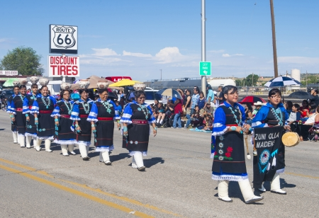 GALLUP , NEW MEXICO - AUGUST 10 : Zuni tribe women with traditional costume participates at the 92 annual Inter-tribal ceremonial parade on August 10 , 2013 in Gallup New-Mexico
