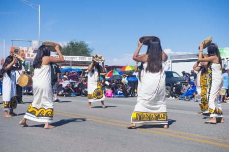GALLUP , NEW MEXICO - AUGUST 10 : Pima tribe women with traditional costume participates at the 92 annual Inter-tribal ceremonial parade on August 10 , 2013 in Gallup New-Mexico
