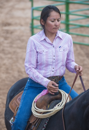 nm: GALLUP , NEW MEXICO - AUGUST 10 : Cowgirl Participates at the 92nd annual Indian Rodeo in Gallup, NM on August 10 2013