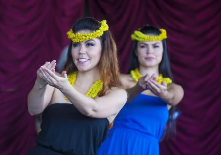 HENDERSON , NEVADA - SEP 15 : Dancers with traditional dress performs Hawaiian dance in the 23rd Annual Hoolaulea Pacific Islands Festival in Henderson Nevada on September 15 , 2013