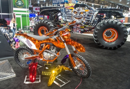 LAS VEGAS - NOV 05 : Colorful motorcycle and giant truck at the SEMA Show in Las Vegas, Navada, on November 05, 2013. The SEMA Show is the premier automotive specialty products trade event in the world.