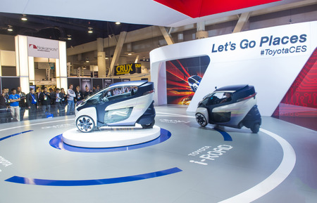 autoshow: LAS VEGAS - JAN 10 : The Toyota i-ROAD on Toyota booth at the CES Show in Las Vegas, Navada, on January 10, 2014. CES is the worlds leading consumer-electronics show and companies from all over the world come to show their latest technologies and product