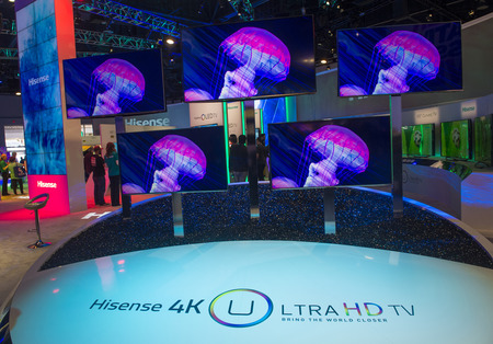 come in: LAS VEGAS - JANUARY 10 : The Hisense booth at the CES show held in Las Vegas on January 10 2014 , CES is the worlds leading consumer-electronics show and companies from all over the world come to show their latest technologies and products.