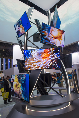come in: LAS VEGAS - JANUARY 10 : The Samsung booth at the CES show held in Las Vegas on January 10 2014 , CES is the worlds leading consumer-electronics show and companies from all over the world come to show their latest technologies and products.  Editorial