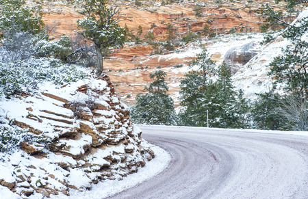 icy conditions: Landscape with a curved icy road Stock Photo