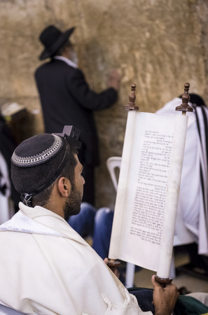 JERUSALEM - JULY 29 : Jewish men prays in the Wailing wall during the Jewish holyday of Tisha Bav , on July 29 2012 in old Jerusalem , Israel  Editorial