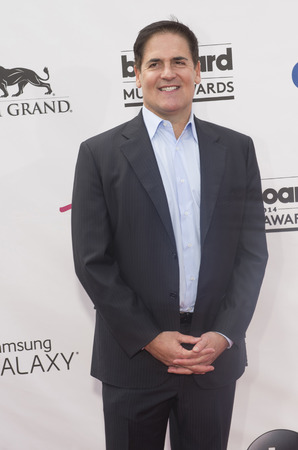 attend: LAS VEGAS - MAY 18 : Businessman Mark Cuban  attend the 2014 Billboard Music Awards at the MGM Grand Garden Arena on May 18 , 2014 in Las Vegas.