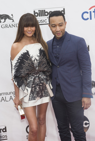christine: LAS VEGAS - MAY 18 : Singersongwriter John Legend (R) and wife model Christine Teigen attend the 2014 Billboard Music Awards at the MGM Grand Garden Arena on May 18 , 2014 in Las Vegas.
