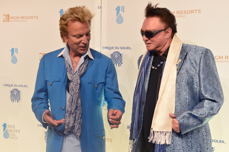 LAS VEGAS - MARCH 21: Former magicians Siegfried (L) and Roy arrives at Cirque du Soleils annual One Night for One Drop at the Mandalay Bay Resort and Casino on March 21, 2014 in Las Vegas, Nevada Editorial