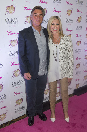 olivia: LAS VEGAS - APRIL 11: Entertainer Olivia Newton-John and her husband, John Easterling, attends the grand opening of her residency show Summer Nights at Flamingo Las Vegas on April 11, 2014  Editorial