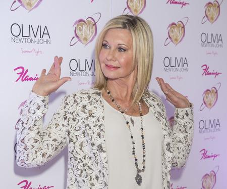 olivia: LAS VEGAS, NV - APRIL 11: Entertainer Olivia Newton-John attends the grand opening of her residency show Summer Nights at Flamingo Las Vegas on April 11, 2014 in Las Vega