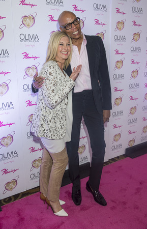 olivia: LAS VEGAS - APRIL 11: Entertainer Olivia Newton-John (L) and television personality RuPaul attends the grand opening of her residency show Summer Nights at Flamingo Las Vegas on April 11, 2014  Editorial