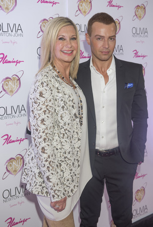 olivia: LAS VEGAS, - APRIL 11: Entertainer Olivia Newton-John (L) and actress Joey Lawrence attends the grand opening of her residency show Summer Nights at Flamingo Las Vegas on April 11, 2014 Editorial