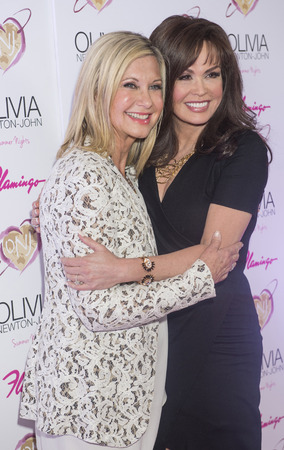 olivia: LAS VEGAS - APRIL 11: Entertainer Olivia Newton-John and singer Marie Osmond attends the grand opening of her residency show Summer Nights at Flamingo Las Vegas on April 11, 2014  Editorial