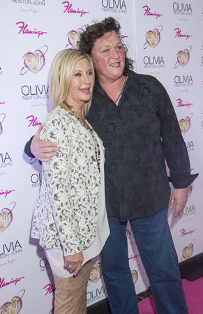 olivia: LAS VEGAS, - APRIL 11: Entertainer Olivia Newton-John (L) and actress Dot Jones attends the grand opening of her residency show Summer Nights at Flamingo Las Vegas on April 11, 2014 Editorial