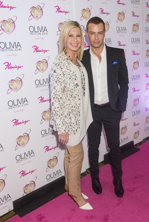 residency: LAS VEGAS, - APRIL 11: Entertainer Olivia Newton-John (L) and actress Joey Lawrence attends the grand opening of her residency show Summer Nights at Flamingo Las Vegas on April 11, 2014 Editorial