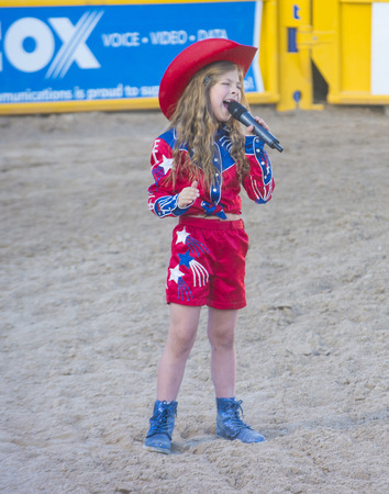 anthem: LAS VEGAS - MAY 16 : Young cowgirl sang the American anthem at the opening of the Helldorado Days Rodeo in Las Vegas ,Nevada on May 16 2014  Editorial