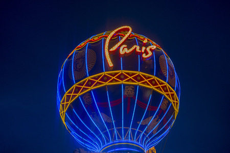 m hotel: LAS VEGAS - JUNE 15 : The Paris Las Vegas hotel and casino on June 15 , 2014 in Las Vegas, Nevada, USA. It includes a half scale, 541-foot (165 m) tall replica of the Eiffel Tower. Editorial