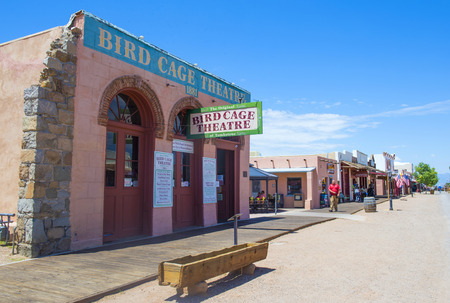 TOMBSTONE , ARIZONA - AUG 09 : A Restored buildings line the main street of Tombstone , Arizona on August 09 2014. Tombstone is a historic western city founded in 1879