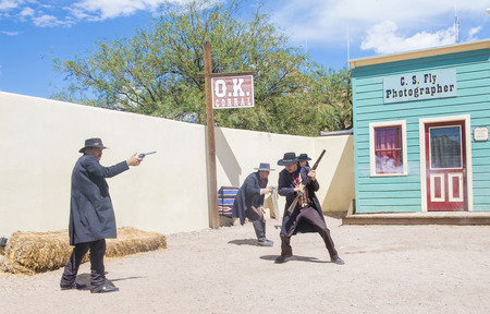 TOMBSTONE , ARIZONA - AUG 09 : Actors takes part in the Re-enactment of the OK Corral gunfight in Tombstone , Arizona on August 09 2014.