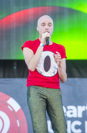 glenn: LAS VEGAS - SEP 20: Singer Tyler Glenn of Neon Trees performs on stage at the 2014 iHeartRadio Music Festival Village on September 20, 2014 in Las Vegas. Editorial