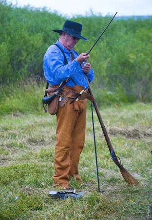 bridger: FORT BRIDGER , WYOMING - AUG 30 : Unidentified participant in the Fort Bridger Rendezvous held in Fort Bridger Wyoming on August 30 2014. Rendezvous is a mountain man celebration of the Fur Trade Era  Editorial