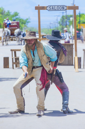 vigilantes: TOMBSTONE , ARIZONA - AUG 09 : A participants in the Vigilante Days event in Tombstone , Arizona on August 09 2014. Vigilantes dedicated to keeping the historical town of Tombstone alive