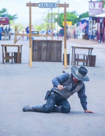 vigilantes: TOMBSTONE , ARIZONA - AUG 09 : A participant in the Vigilante Days event in Tombstone , Arizona on August 09 2014. Vigilantes dedicated to keeping the historical town of Tombstone alive  Editorial