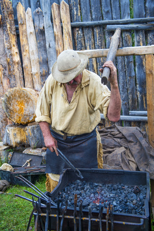 bridger: FORT BRIDGER , WYOMING - AUG 30 : Blacksmithing demo during the Fort Bridger Rendezvous held in Fort Bridger Wyoming on August 30 2014. Rendezvous is a mountain man celebration of the Fur Trade Era