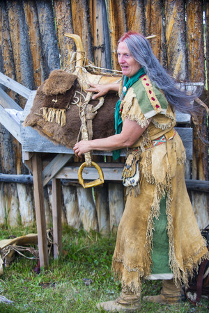 bridger: FORT BRIDGER , WYOMING - AUG 30 : Unidentified participant in the Fort Bridger Rendezvous held in Fort Bridger Wyoming on August 30 2014. Rendezvous is a mountain man celebration of the Fur Trade Era