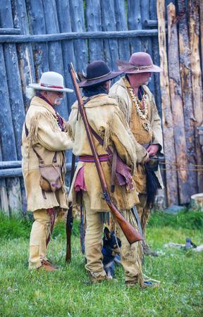bridger: FORT BRIDGER , WYOMING - AUG 30 : Unidentified participants in the Fort Bridger Rendezvous held in Fort Bridger Wyoming on August 30 2014. Rendezvous is a mountain man celebration of the Fur Trade Era
