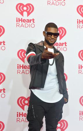 acomodador: LAS VEGAS - 19 de septiembre: La artista Usher asiste el 2014 iHeartRadio Music Festival en el MGM Grand Garden Arena el 19 de septiembre de 2014 en Las Vegas.