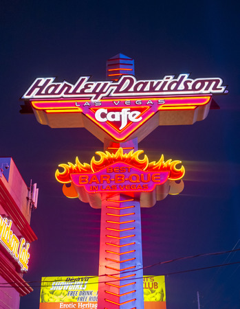 sportster: LAS VEGAS - SEP 18: The Harley Davidson Cafe in Las Vegas strip on September 18 2014. In the facade there is a 7.1:1 scale replica Sportster weighing 1,200 lbs and measuring 32 feet.