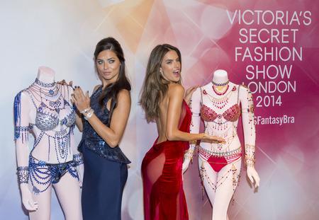 victoria secret: LAS VEGAS - NOV 13 : Models Adriana Lima (L) and Alessandra Ambrosio attend the Victorias Secret Dream Angels Fantasy Bra debut at the Fashion Show mall on November 13, 2014 in Las Vegas.