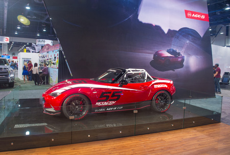 mazda: LAS VEGAS - NOV 07 : Mazda MX-5 sport car at the SEMA Show in Las Vegas, Navada, on November 07, 2014. The SEMA Show is the premier automotive specialty products trade event in the world. Editorial