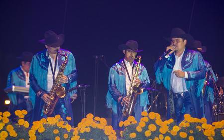 dia de los muertos: COACHELLA , CALIFORNIA - NOV 01 : Members of the band Banda Machos perform live on stage at the Dia De Los Muertos celebration in Coachella , California on November 01 2014