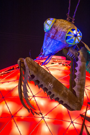 three story: LAS VEGAS - OCT 31 : The Giant Praying Mantis Sculpture in front of Container park in Downtown Las Vegas on October 31 2014. The three story Container Park is made from shipping containers Editorial