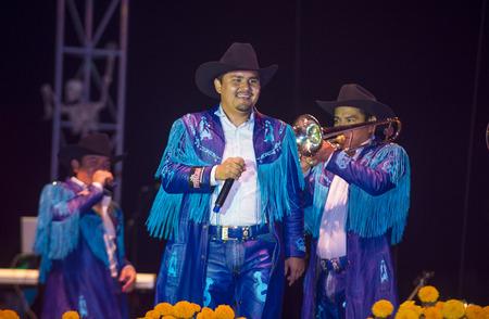 COACHELLA , CALIFORNIA - NOV 01 : Members of the band Banda Machos perform live on stage at the Dia De Los Muertos celebration in Coachella , California on November 01 2014