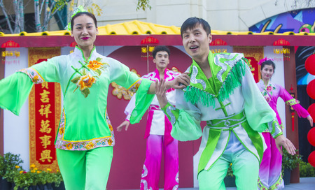 folk heritage: LAS VEGAS - FEB 21 : Chinese folk dancers perform at the Chinese New Year celebrations held in Las Vegas , Nevada on February 21 2015 Editorial