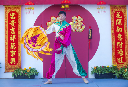 folk heritage: LAS VEGAS - FEB 21 : Chinese folk dancer perform at the Chinese New Year celebrations held in Las Vegas , Nevada on February 21 2015
