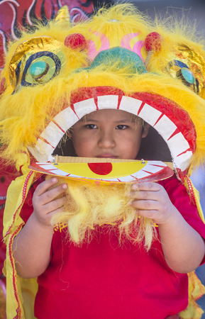 playing folk: LAS VEGAS - FEB 21 : A young participant at the Chinese New Year parade held in Las Vegas , Nevada on February 21 2015