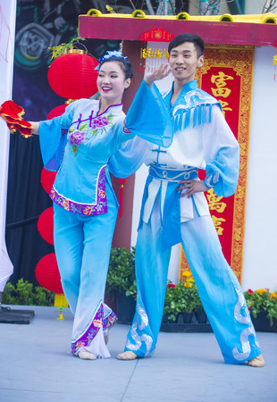 playing folk: LAS VEGAS - FEB 21 : Chinese folk dancers perform at the Chinese New Year celebrations held in Las Vegas , Nevada on February 21 2015 Editorial