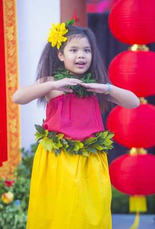 playing folk: LAS VEGAS - FEB 21 : Tahitian folk dancer perform at the Chinese New Year celebrations held in Las Vegas , Nevada on February 21 2015