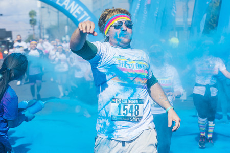 hosted: LAS VEGAS - FEB 28 : An unidentified runner at the Las Vegas Color Run on February 28 2015. The Color Run is a 5k worldwide hosted fun race