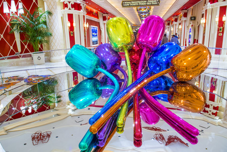 million dollars: LAS VEGAS - APR 23 : The Jeff Koons Tulips Sculpture display at the Wynn Hotel in Las Vegas on April 23 , 2015. The sculpture purchased by Steve Wynn in 2012 for $33.6 million dollars