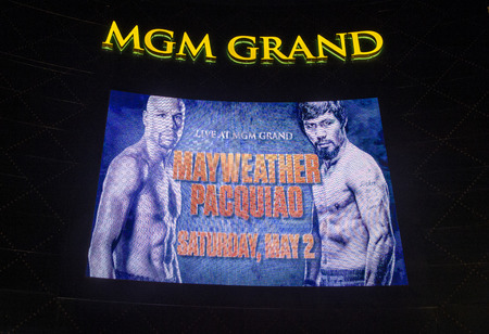 scheduled: LAS VEGAS - APR 28 : A sign at the MGM Grand advertises about the Floyd Mayweather and Manny Pacquiao fight on April 28 2015 in Las Vegas , the fight scheduled to May 2 2015