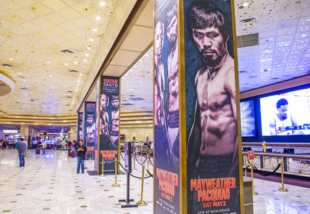 scheduled: LAS VEGAS - APR 28 : Posters at the MGM Grand hotel lobby advertises about the Floyd Mayweather and Manny Pacquiao fight on April 28 2015 in Las Vegas , the fight scheduled to May 2 2015